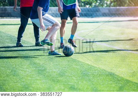 Selective Focus To Soccer Player Control And Shoot Ball To Goal With Goalkeeper.