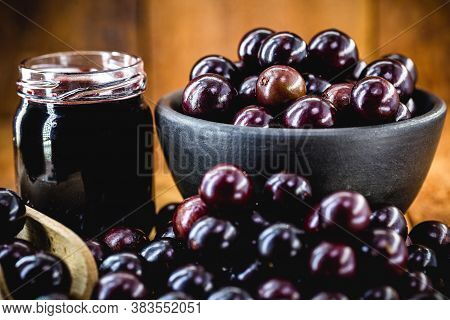 Brazilian Grape Jam, On A Rustic Wooden Table. Jabuticaba, Exotic Fruit From Brazil, Used In Cooking