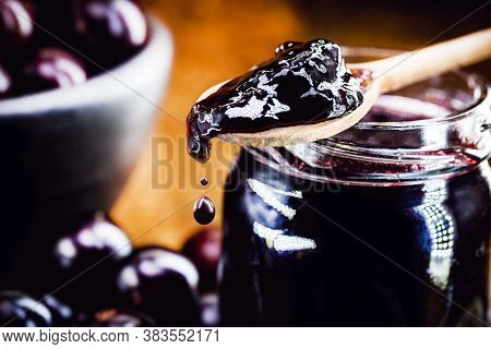 Drop Of Jam Dripping From The Spoon. Brazil Grape Jelly, Called Jaboticaba Or Jabuticaba