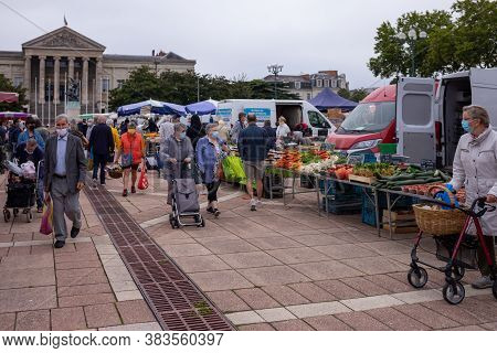 Angers, France - August 29 2020: People Wearing Face Protective Mask While Shopping In The Market Pl