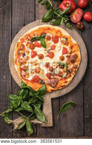 Pizza Margarita Cut In Slices On A Wooden Background. Fast Food. Unhealthy Food. Tasty Pizza. Pizza