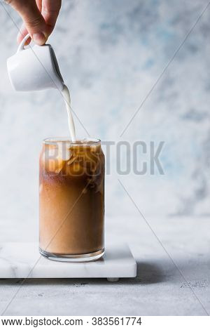 Frappe Milk Shake Coffee In Tall Glass On Blue Background. Frappe Milk Shake Coffee