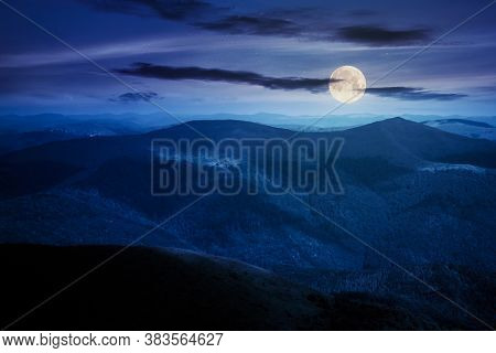 Mountain Landscape On A Summer Night. Hills Rolling From The Valley Up In To The Distant Ridge. View