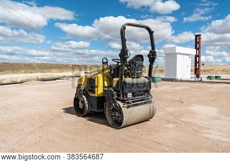 Small Steamroller At A Construction Site, Leveling The Ground