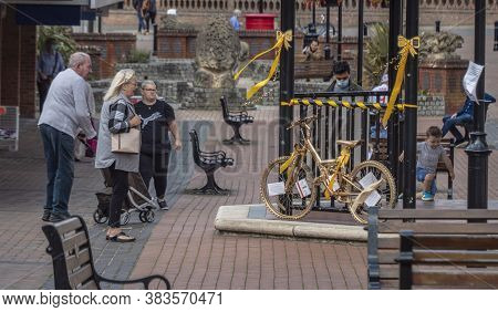 Burgess Hill, United Kingdom - 2 September, 2020. A Bike Sprayed With Gold Is Displayed In The Middl