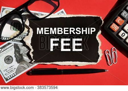 Membership Fee. Text On A Red Background On Black Paper In White Letters. Near Glasses, Bills Of Mon