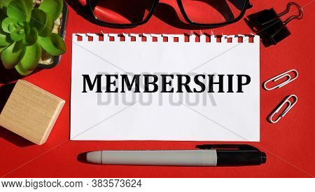 Membership. Text On White Sheet Of Paper, On Red Background