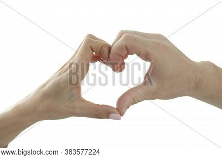 Male And Female Hand Make Heart Shape On Background Of Window. Love And Understanding In A Relations