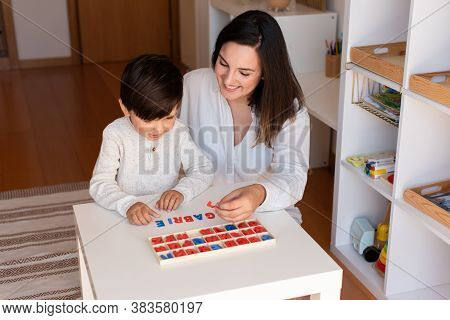 Lillte Kid Learning To Write And Read With A Alphabet And Mother Or Teacher Help. Homeshooling. Lear