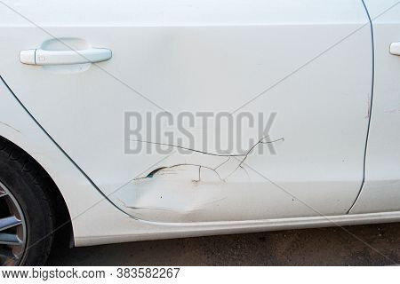 Dent, Scratch On The White Car Door Paint