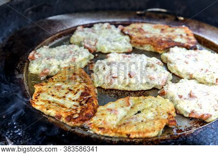 Fried Potato Pancakes On The Grill. Unhealthy Fatty Food. Frying Grated Potatoes Pancakes In The Fry
