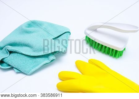 Yellow Rubber Gloves, Brush And Microfiber Wipe On White Surface, Housecleaning And Housework Concep