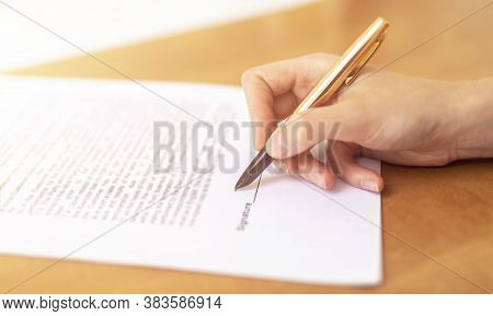 Close Up Woman Hand Hold Golden Pen Sign Contract Put Signature, Make Investment, Taking Insurance,
