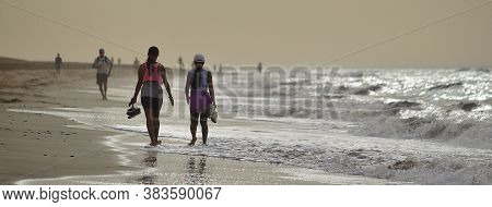 Beach With People Walking Along The Shore, Maspalomas, South Of Gran Canaria, Canary Islands