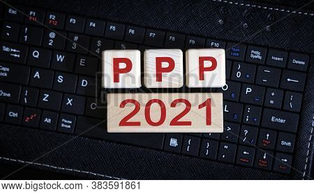 Ppp 2021 Concept. Wooden Cubes On A Black Keyboard