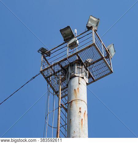 The Observation Floodlight Platform Is Installed On A Pole. The Ladder For Ascent And Descent Is Vis