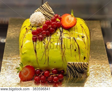 Culinary Art Green Cake With Berry Decor