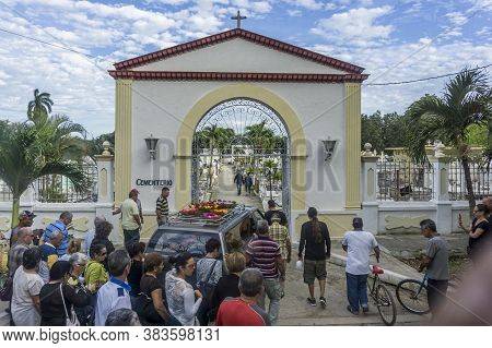 Cuba, February 2016 - Funeral Procession And Funeral Car Converging To The Entrance Of Cemetery