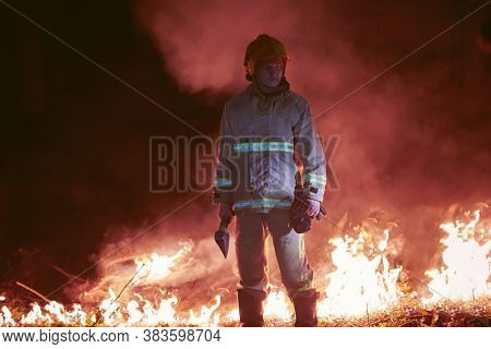 firefighter portrait on authentic fire location in forest