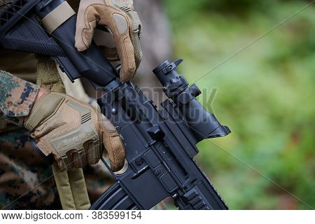 marine corps special operations soldier preparing tactical and commpunication gear for action battle closeup