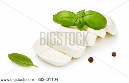 Pieces Of Mozzarella Buffalo Cheese With Basil Leaves. Sliced Cheese With Black Peppers Isolated On