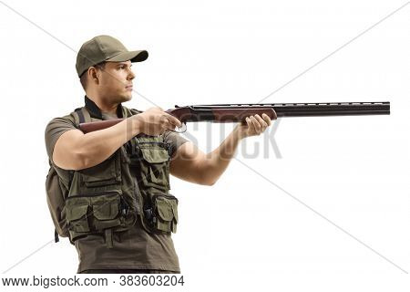 Man standing and aiming with a shotgun isolated on white background