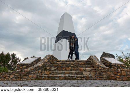 Vila De Rei, Portugal - March 30, 2019: Couple Kissing In Geographical Center Picoto Melrica Centro