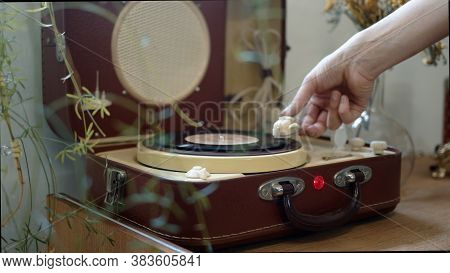 Hands Putting A Vinyl Disc On A Player, Close Up Female Hands Put The Needle On A Record, Playing Vi