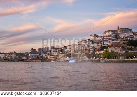 Coimbra City View At Sunset With Mondego River And Beautiful Historic Buildings, In Portugal
