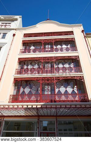 Coimbra, Portugal - April 7, 2019: Beautiful Antique Red And White Buildings In Coimbra Historic Cen
