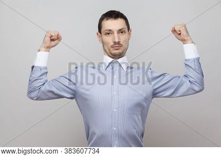 I Am Strong. Portrait Of Serious Proud Handsome Bristle Businessman In Classic Blue Shirt Standing A