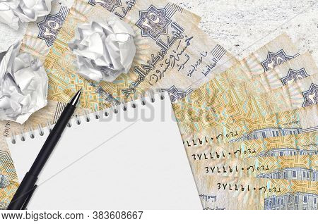25 Egyptian Piastres Bills And Balls Of Crumpled Paper With Blank Notepad. Bad Ideas Or Less Of Insp