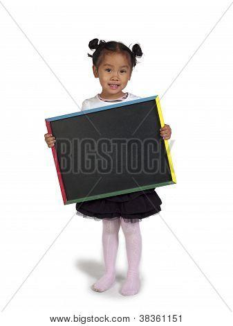 Happy Little Asian Girl Holding Chalkboard