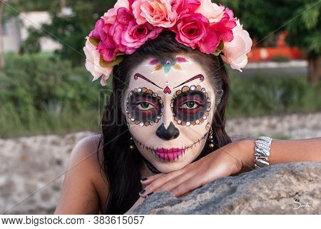Portrait Of Calavera Catrina. Young Woman With Sugar Skull Makeup. Day Of The Dead. Halloween.