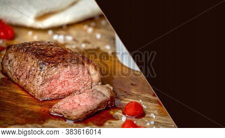 Grilled Picanha, Traditional Brazilian Cut On A Wooden Board, With Campaign And Pepper Sauce, Tradit