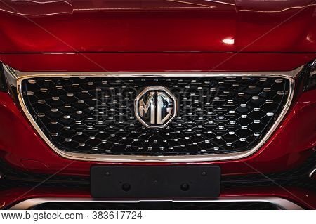 Roi Et, Thailand - June 22, 2020: Close Up Mg Logo Car With The Front Grille Of Red Mg Car At Robins