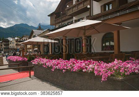 San Martino Di Castrozza, Italy - July 20, 2020: View Of San Martino Di Castrozza With Many Flowers