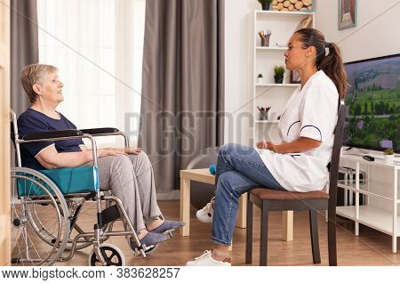 Old Woman Who Benefits From Home Care Service. Disabled Handicapped Old Pensioner Person Recovering