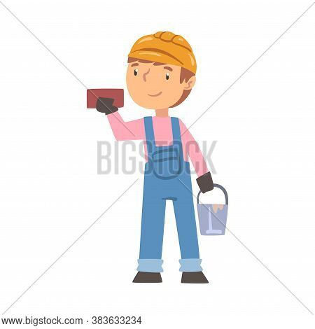 Boy Construction Worker With Bucket And Brick, Cute Little Builder Character Wearing Blue Overalls A
