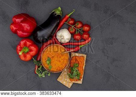 Traditional Autumn Balkan Vegan Spread Ajvar, Malidzano, Or Pinjur Made Of Red Bell Pepper, Chili, E