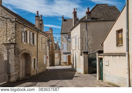 Meursault, Burgundy, France- July 9, 2020: The Street With Ancient Buildings In The Meursault.