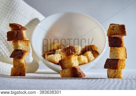Square Toasted Pieces Of Homemade Delicious Rusk, Hardtack, Dryasdust, Zwieback Stand In Columns Nea