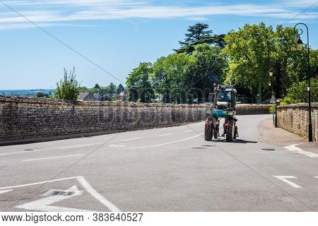 Meursault, Burgundy, France- July 9, 2020: Mechanical Grape Harvester In The Meursault Streets, Sout