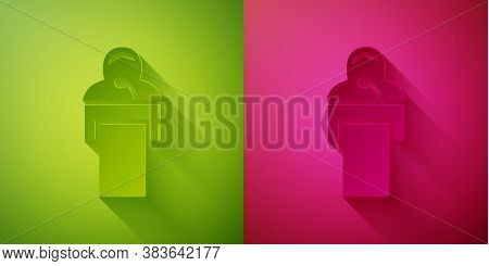 Paper Cut Gives Lecture Icon Isolated On Green And Pink Background. Stand Near Podium. Speak Into Mi