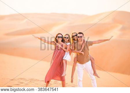 Young Family Of Four In Big Sand Desert