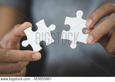 White Jigsaw In The Hands Of Humans, The Correct Solution. Teamwork, Solving And Completing The Task