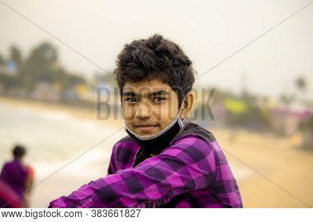 Chennai , Tamilnadu - India . September 2, 2020 .a Hindu Boy Enjoys Chennai Beach In The Morning Wit