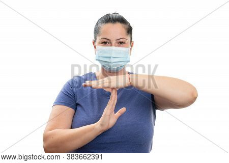 Adult Woman Making Pause Timeout Gesture With Hands Wearing Medical Or Surgical Face Mask Covering F