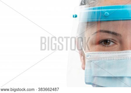 Half Face Close-up Of Adult Woman Model Wearing Transparent Shield And Surgical Or Medical Disposabl