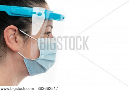 Side-view Close-up Of Woman Model Wearing Transparent Face Shield And Medical Or Surgical Mask Cover